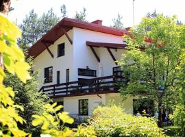 Dom nad Tanwią, Narol