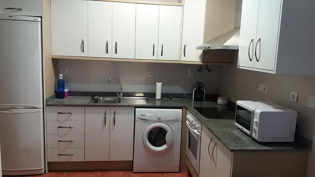 مطبخ أو مطبخ صغير في Apartamento Pueblo de Pescadores