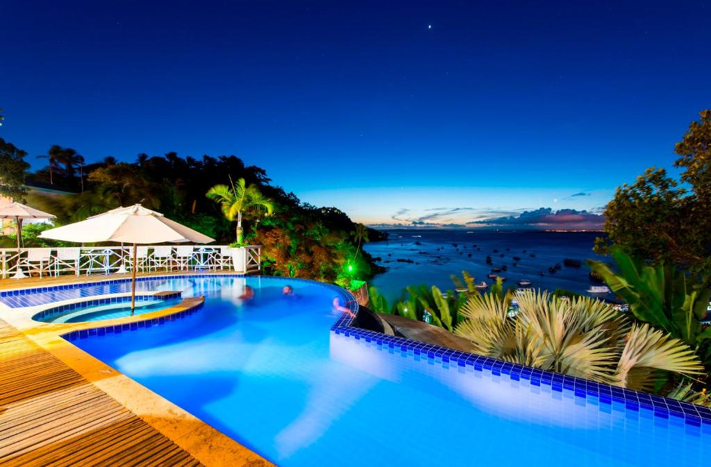 A piscina localizada em Passárgada Pousada e Restaurante ou nos arredores