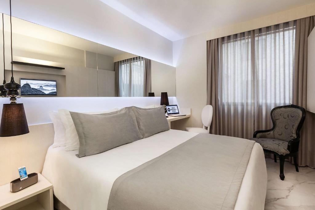 Cama ou camas em um quarto em BEST WESTERN Plus Copacabana Design Hotel
