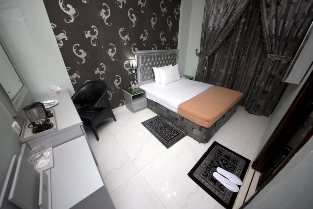 Cama ou camas em um quarto em White Fort Hotel