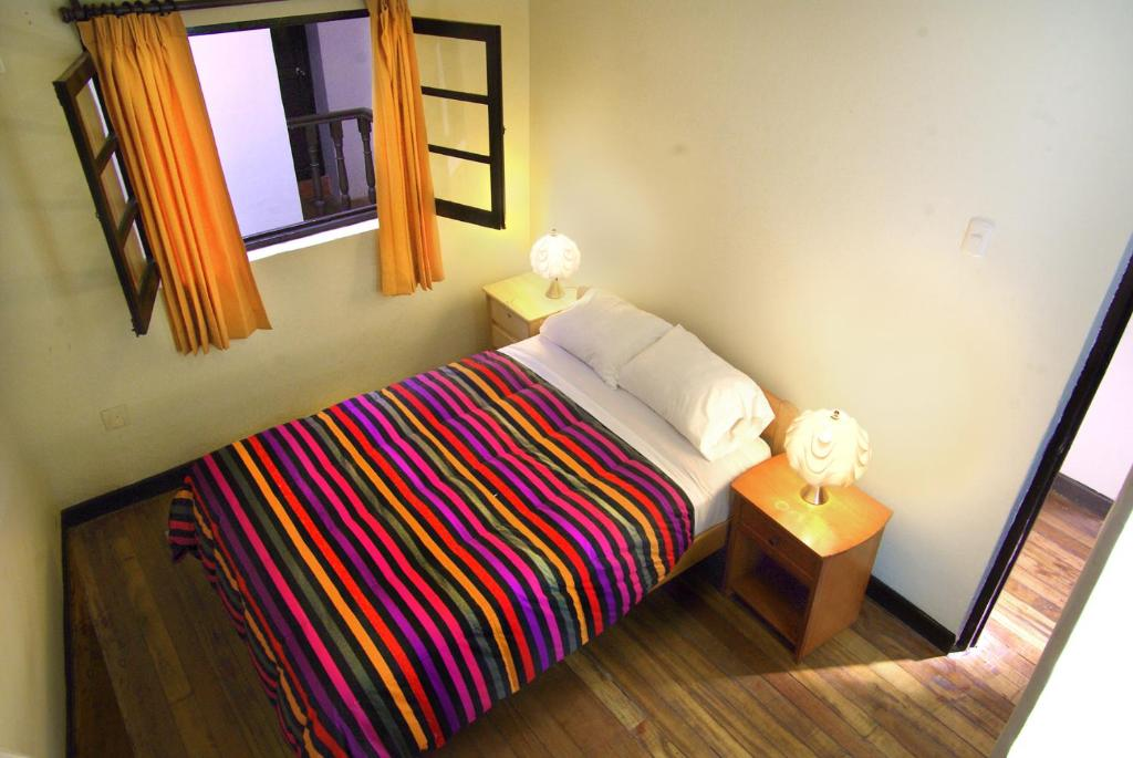 Cama ou camas em um quarto em Mama Simona Hostel - Cusco