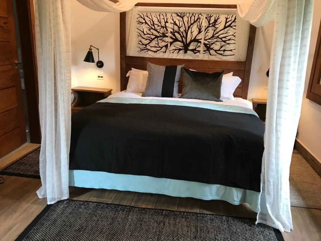 Cama ou camas em um quarto em Chalé Realli