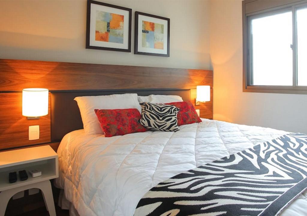Cama ou camas em um quarto em Flat no Brooklin 186