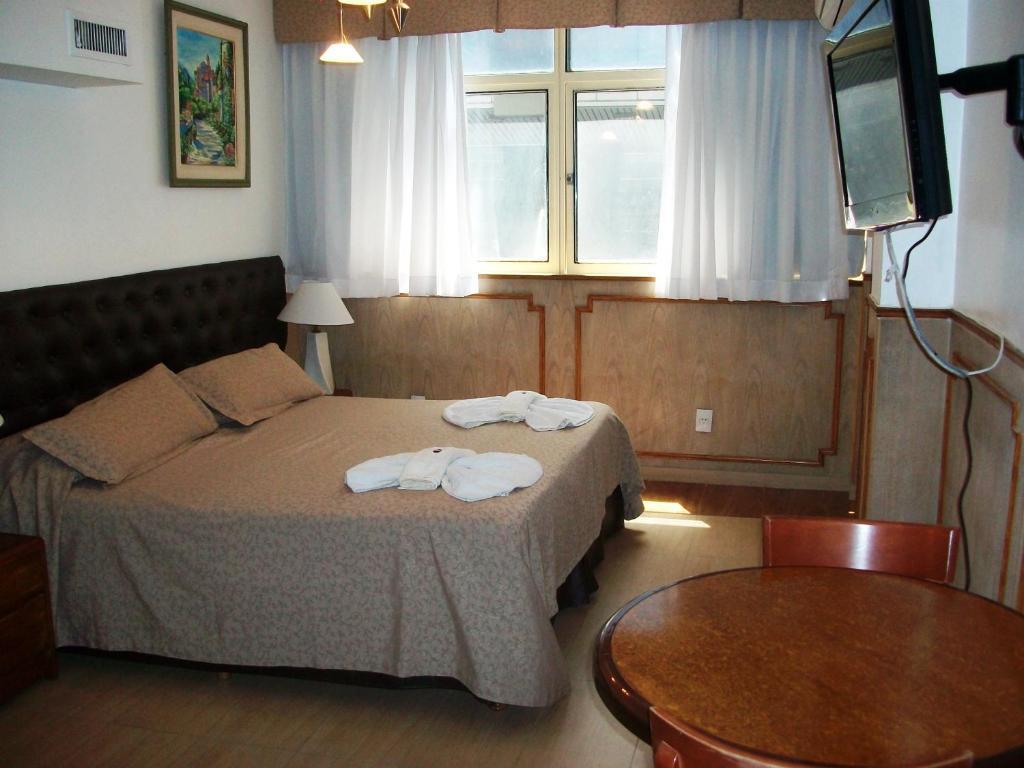 מיטה או מיטות בחדר ב-Village Garden Apart Hotel