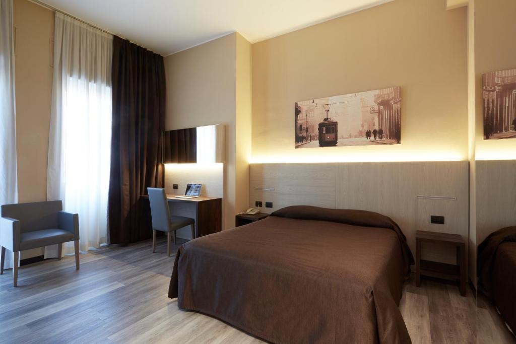Uma cama ou camas num quarto em Hotel Ritter