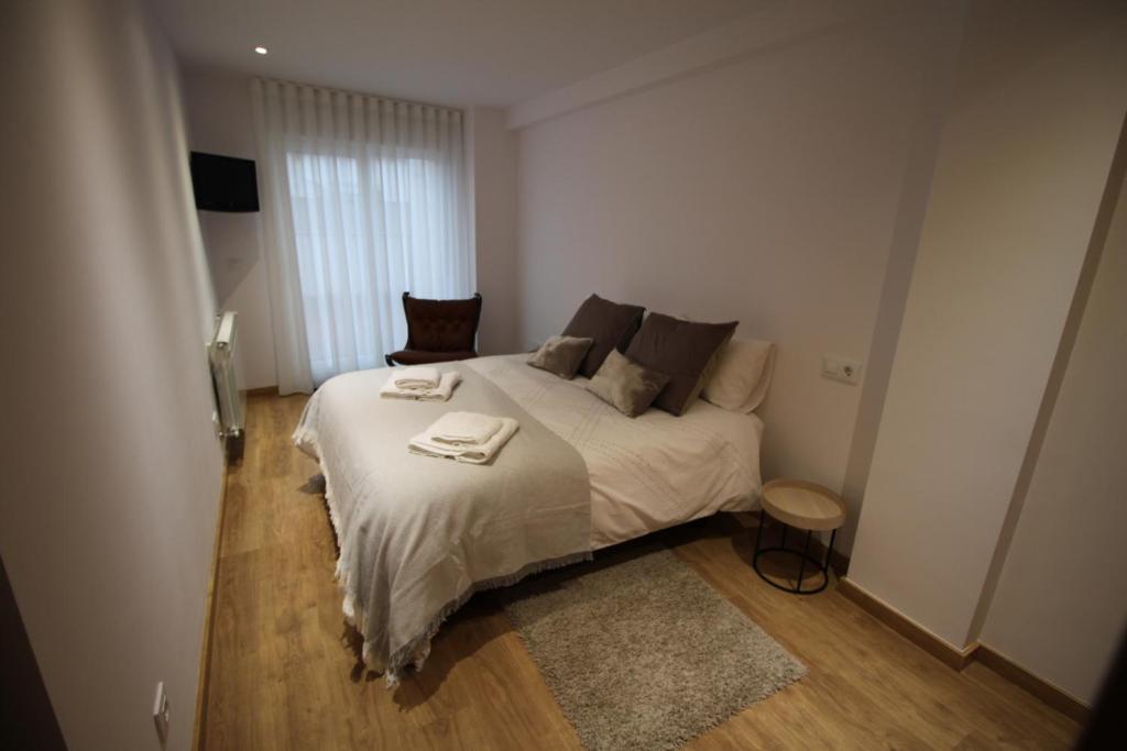 Giường trong phòng chung tại Apartamento La Paz