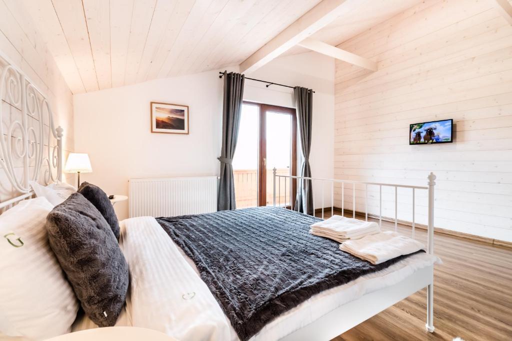 מיטה או מיטות בחדר ב-Green Resort Bran
