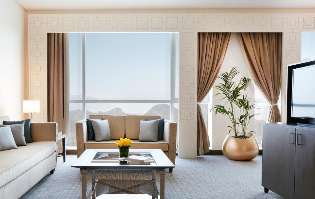 אזור ישיבה ב-Royal M Hotel Fujairah Mall