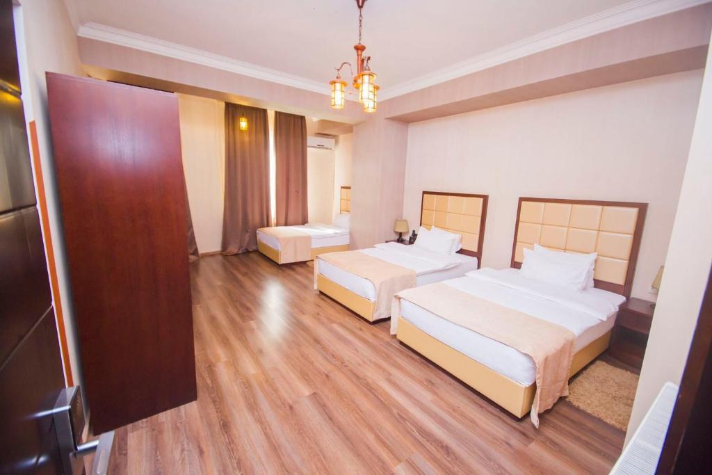 سرير أو أسرّة في غرفة في أوريون ايكونوم