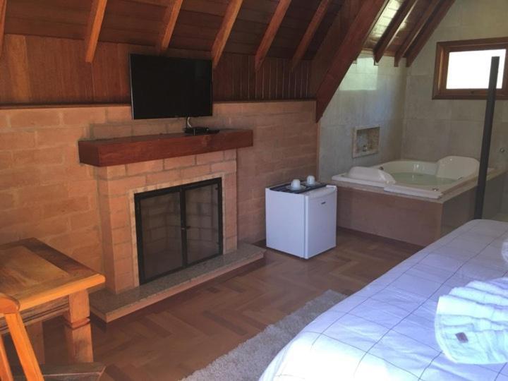A cozinha ou cozinha compacta de Chalés Amabilis