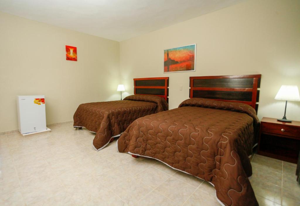 Una cama o camas en una habitación de Hotel Cortecito Inn Bavaro