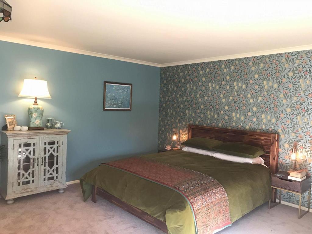 Cama ou camas em um quarto em Quince Lodge - Bed & Breakfast