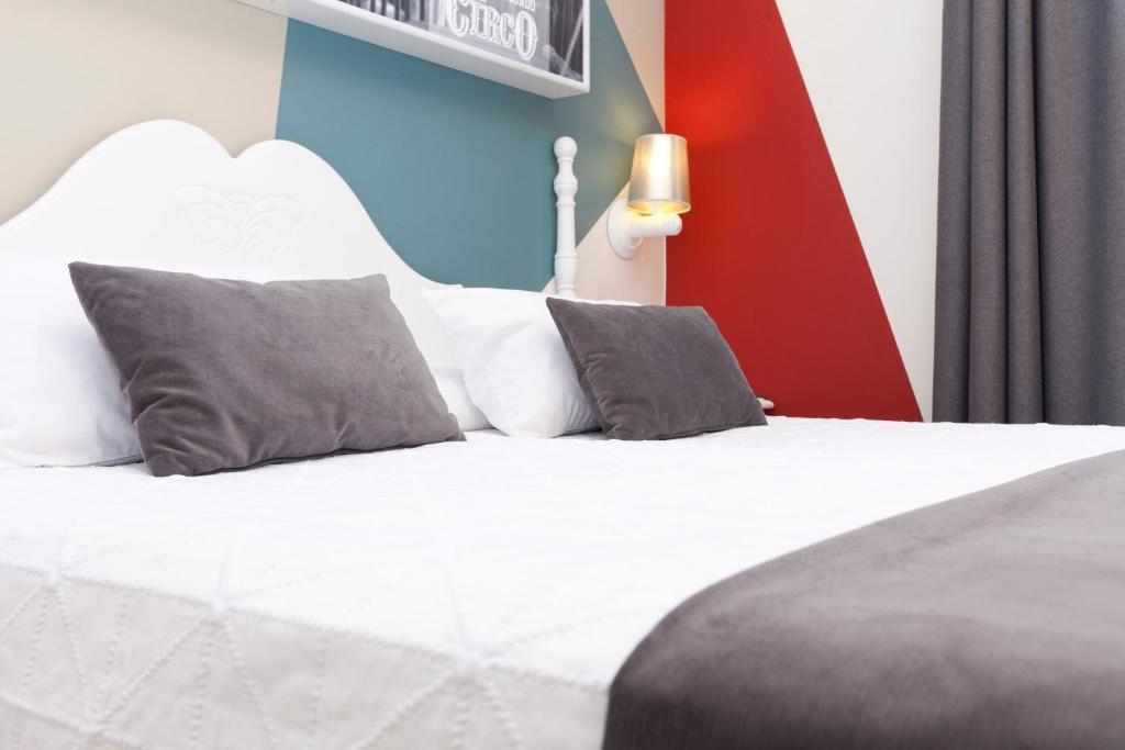 מיטה או מיטות בחדר ב-Hotel Carlos V