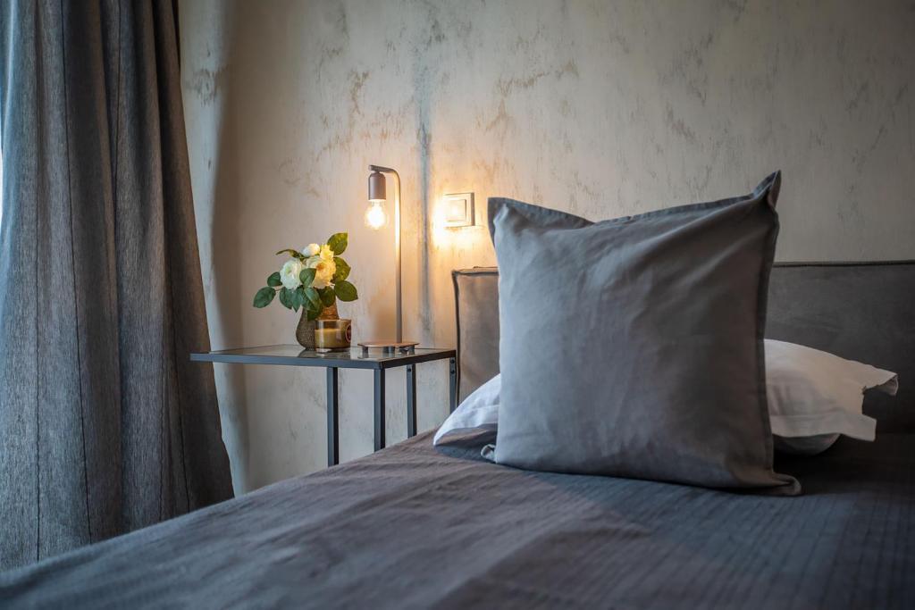 מיטה או מיטות בחדר ב-Cosmopolit Booking