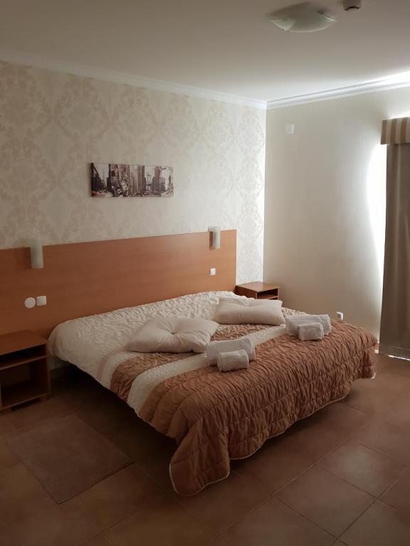 Una cama o camas en una habitación de Clube da Lapa