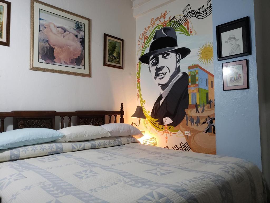 Una cama o camas en una habitación de CasaTripGoGo