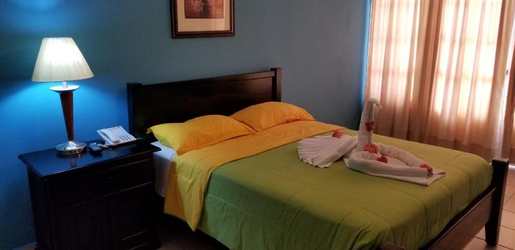 Una cama o camas en una habitación de Terra Linda Resort