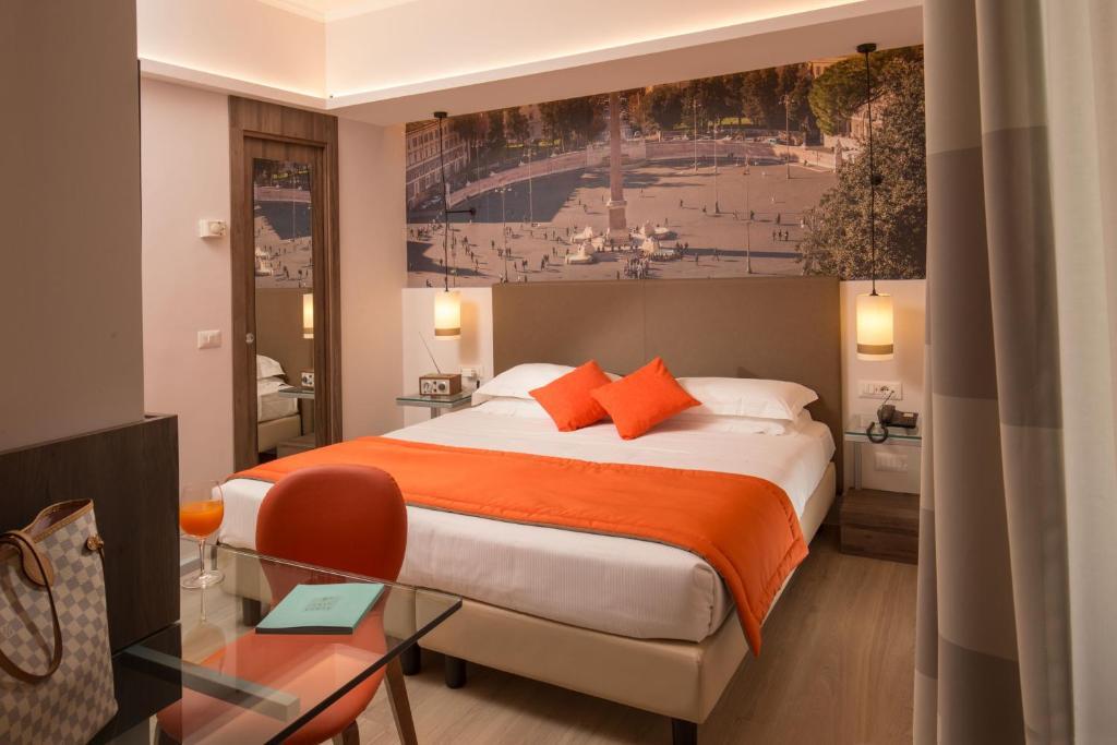 מיטה או מיטות בחדר ב-Hotel Villa Grazioli