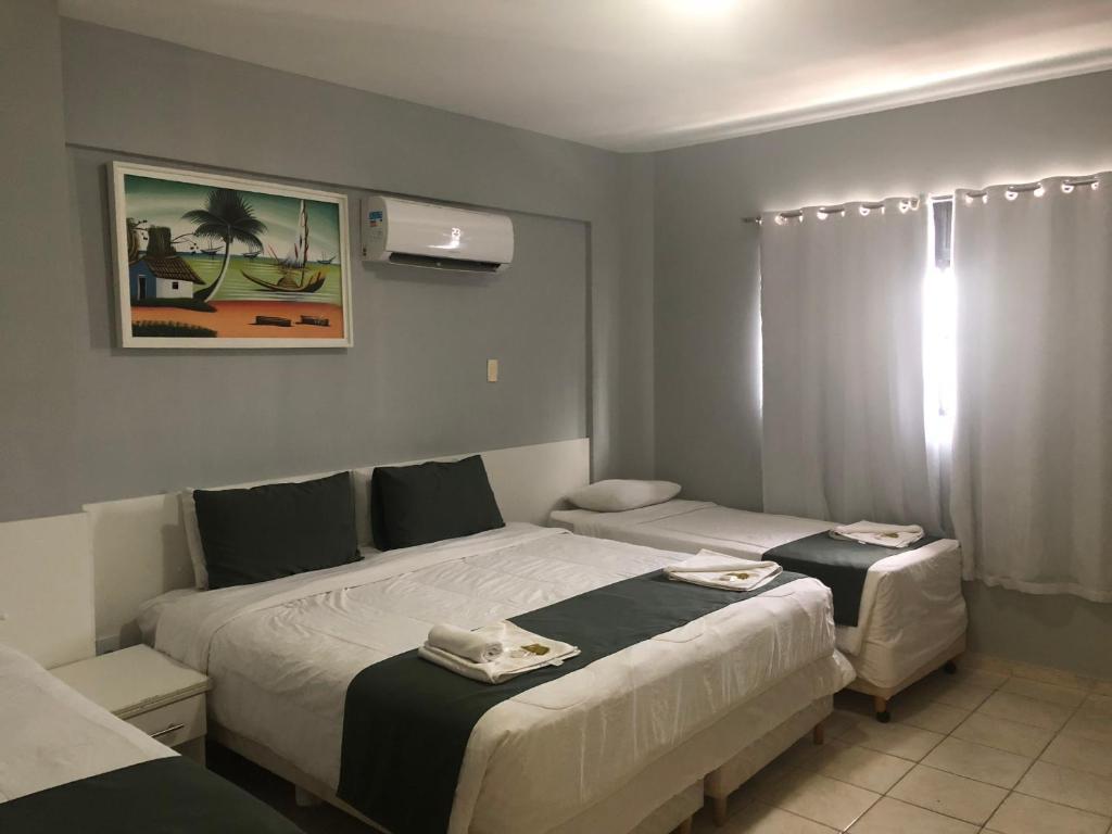 Cama ou camas em um quarto em Hotel Filipéia