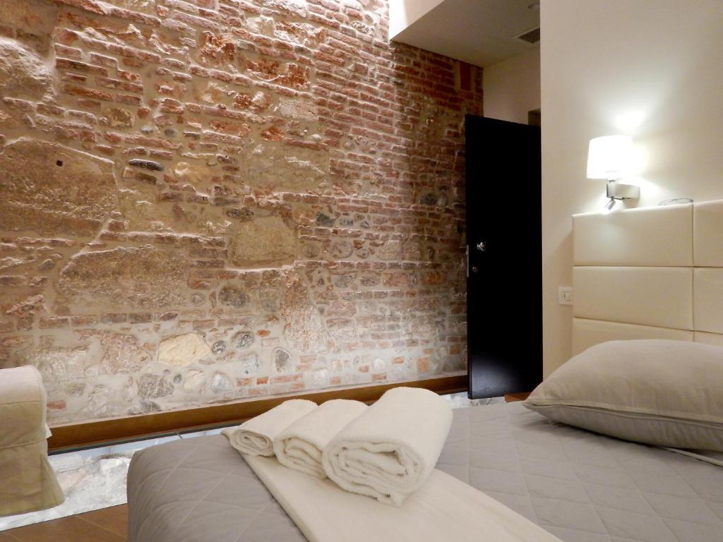Cama ou camas em um quarto em Arena Luxury Suite