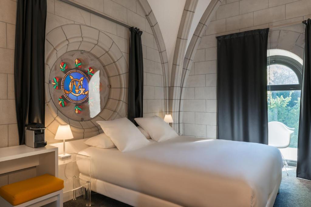 מיטה או מיטות בחדר ב-Sozo Hotel