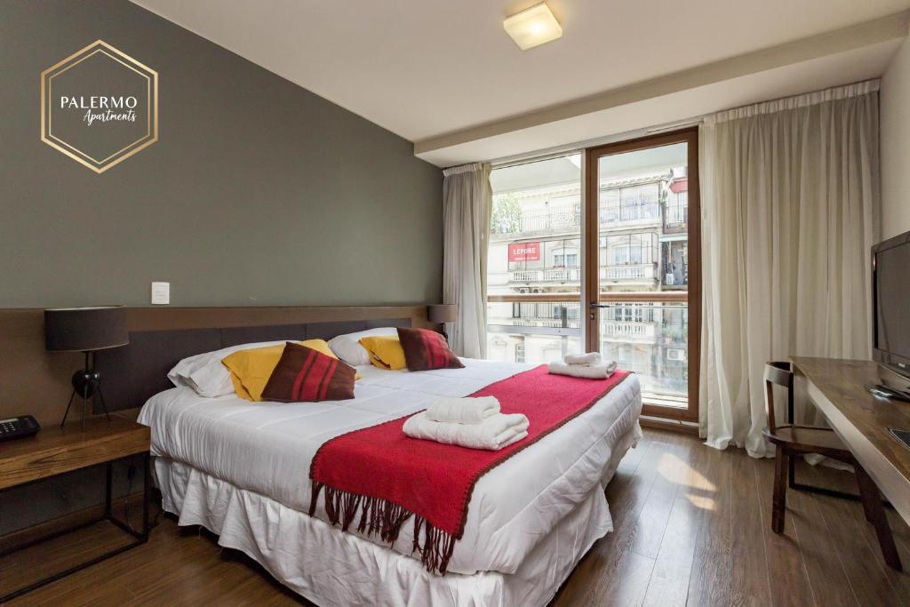 Cama ou camas em um quarto em Palermo Apartments