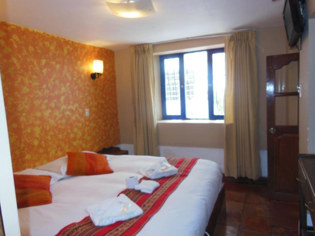 Cama ou camas em um quarto em Hostal Illapa Inn
