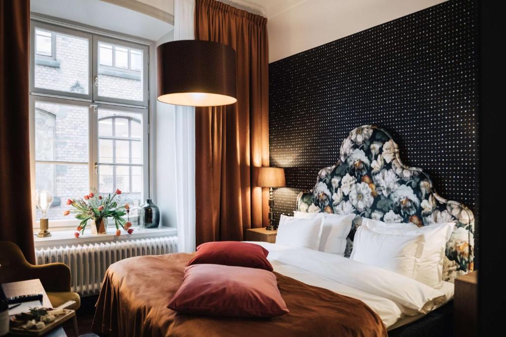 מיטה או מיטות בחדר ב-NOFO Hotel; BW Premier Collection