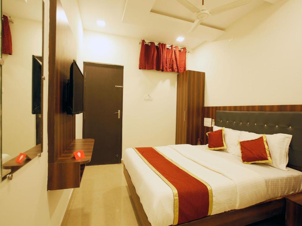 מיטה או מיטות בחדר ב-AK International