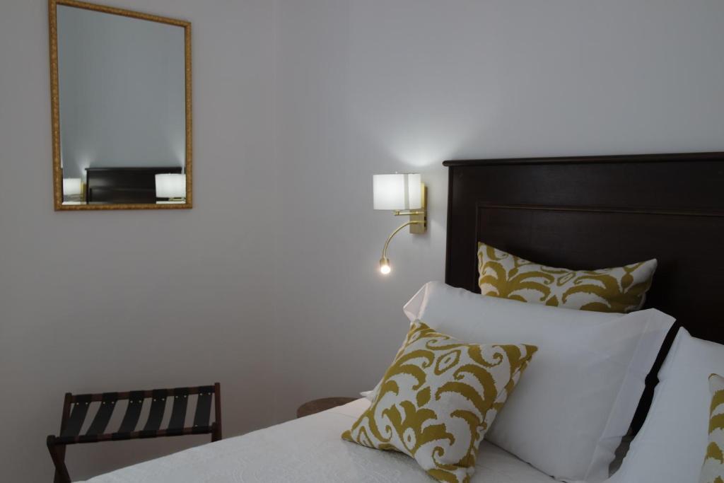 Giường trong phòng chung tại Hotel Livio
