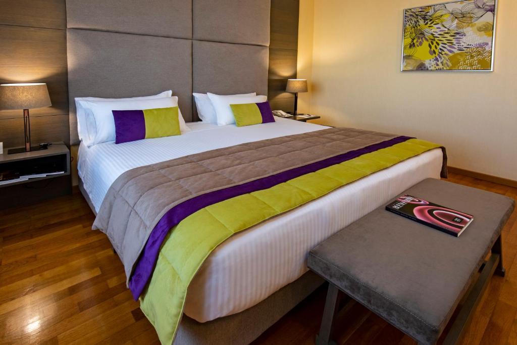 Una cama o camas en una habitación de Hotel Grand Brizo Buenos Aires