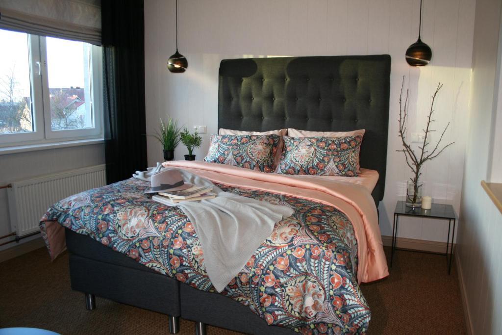 Cama ou camas em um quarto em Sadama street Villa