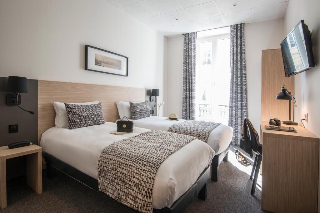 Cama ou camas em um quarto em Hotel Saint Gothard
