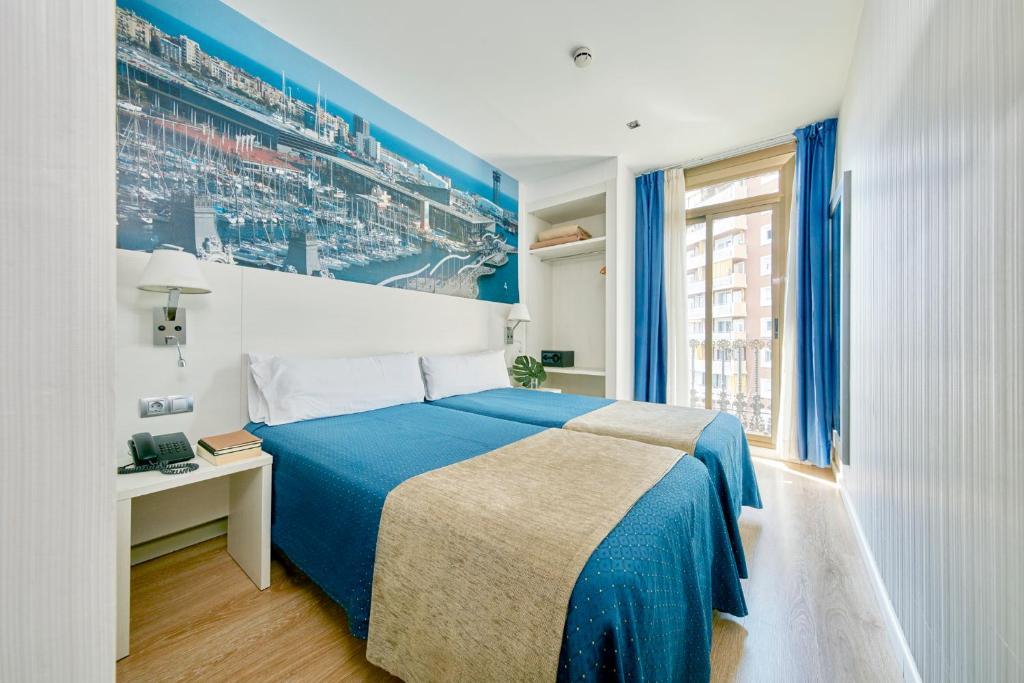 מיטה או מיטות בחדר ב-Hotel Transit