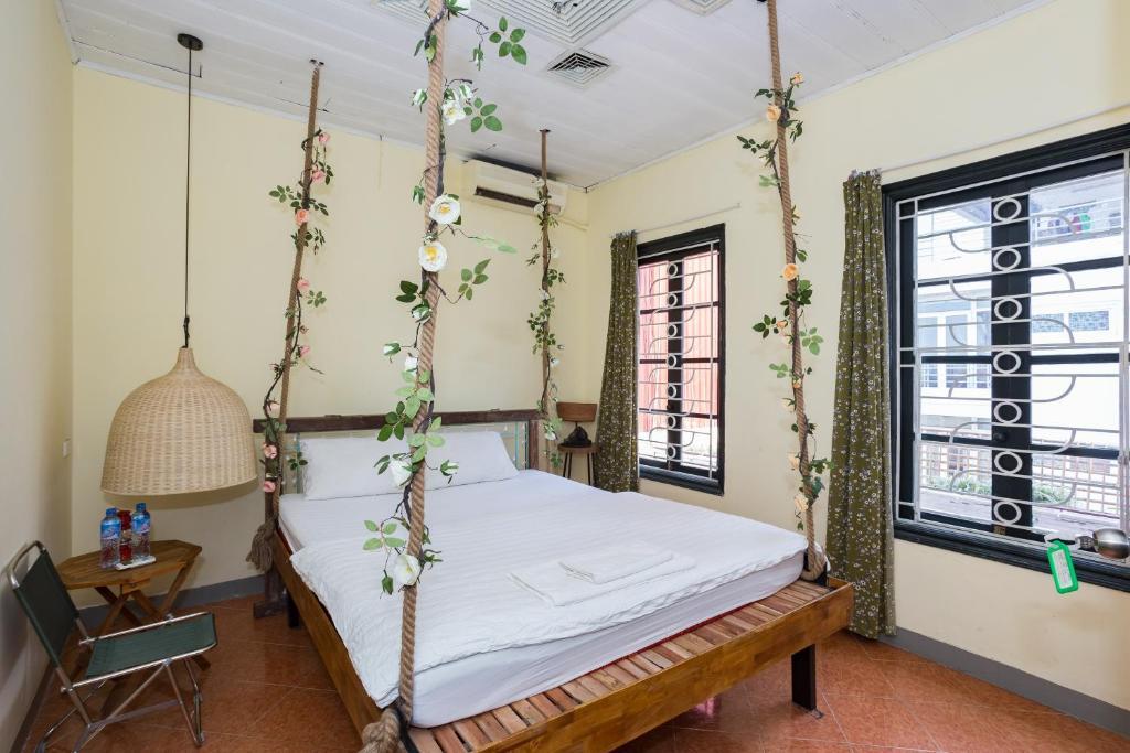 Giường trong phòng chung tại Hanoian Backpack Hostel