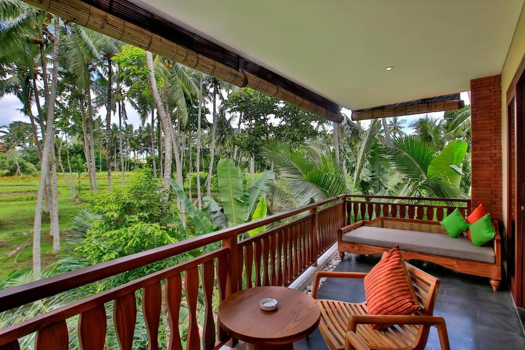 Un balcón o terraza en Green Field Resort Ubud