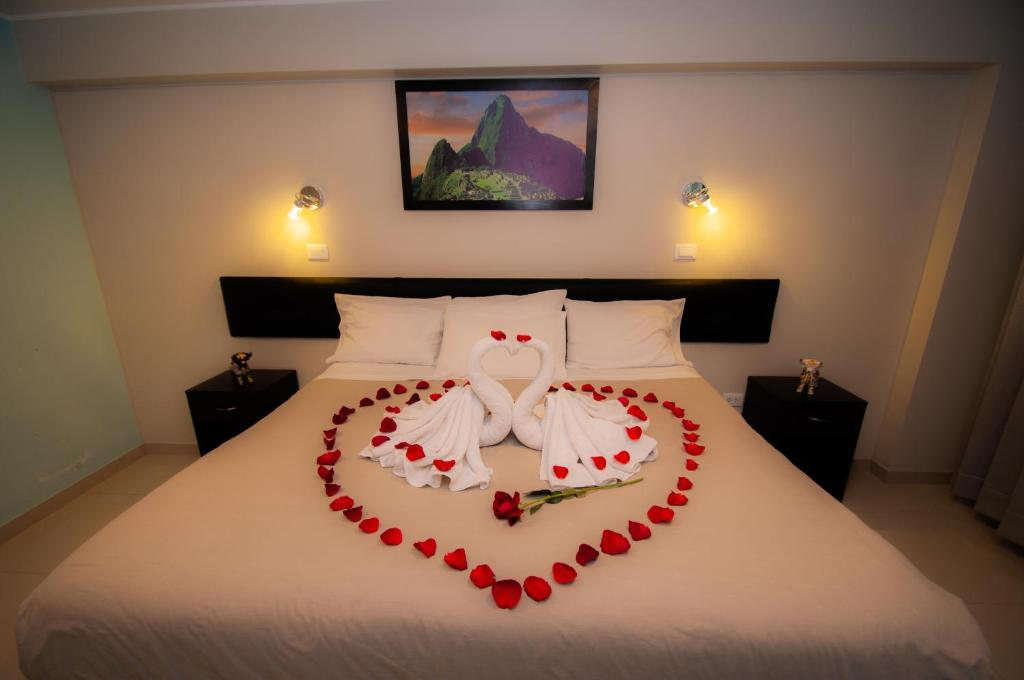 1cc8d0cbc22 Una cama o camas en una habitación de Maria Bonita