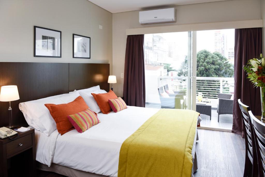 Una cama o camas en una habitación de Argenta Suites Belgrano
