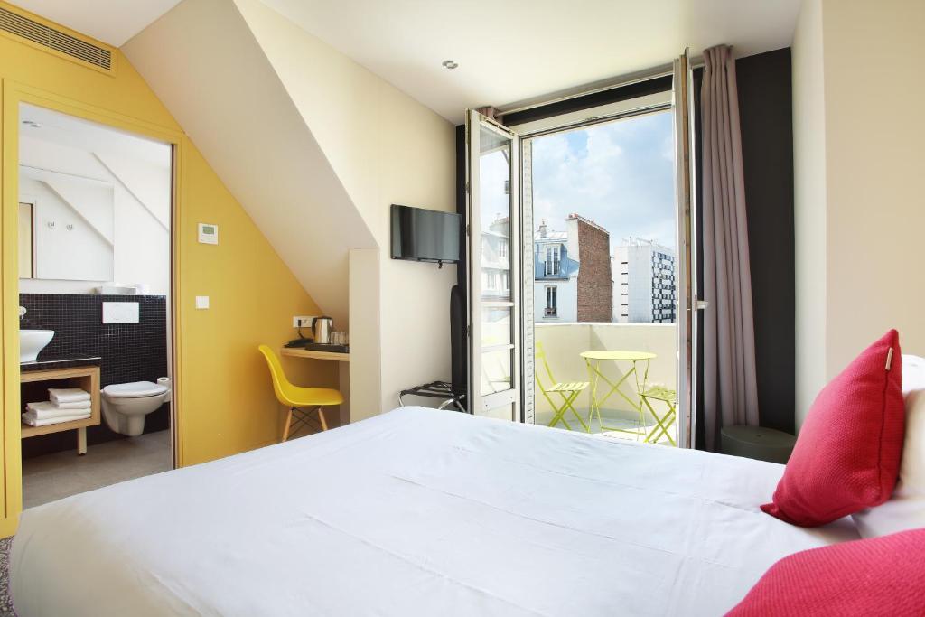 מיטה או מיטות בחדר ב-Hotel Auguste