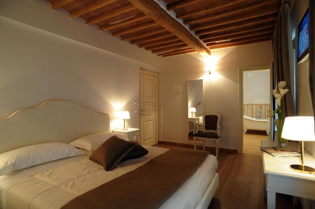 Cama ou camas em um quarto em Le Camere Del Ceccottino