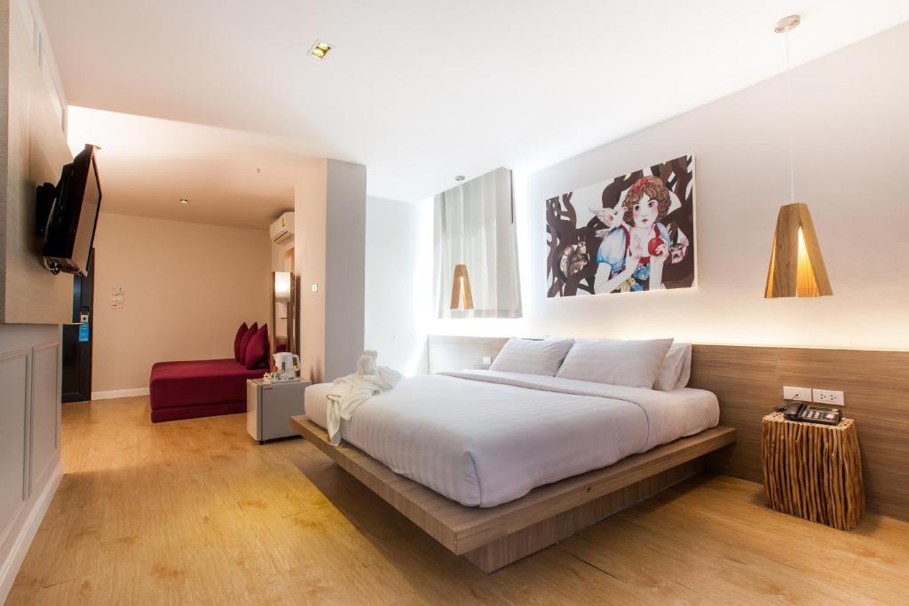 Una cama o camas en una habitación de THE BED Hatyai