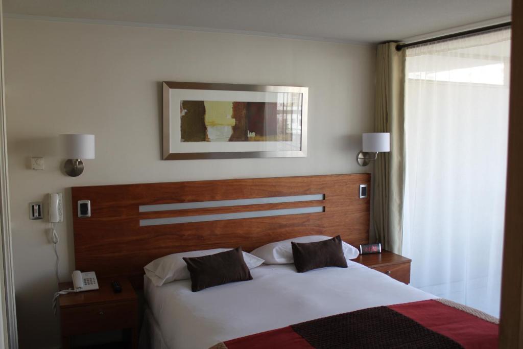 Cama ou camas em um quarto em Rentaparts Sucursal Apoquindo