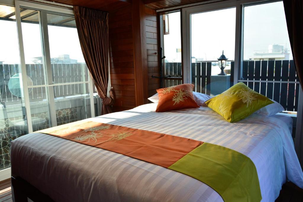 מיטה או מיטות בחדר ב-Adamaz House