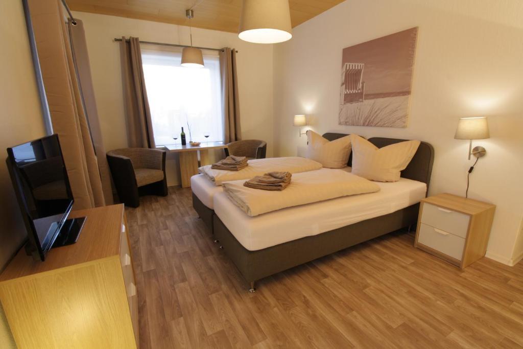 Giường trong phòng chung tại Seebrise Grömitz