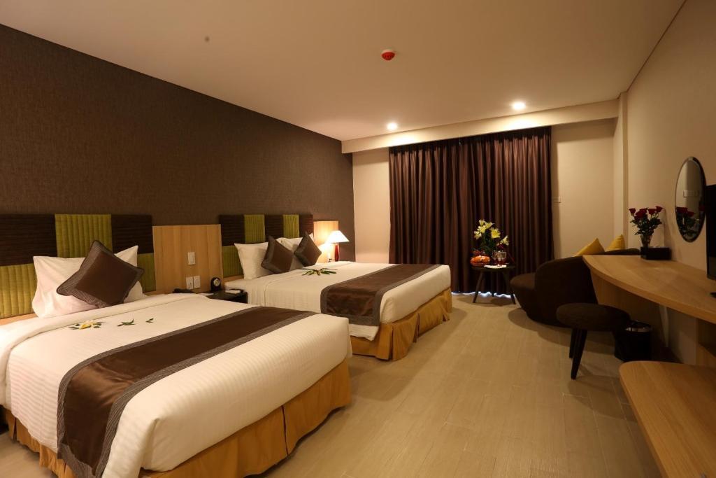 Phòng Deluxe với Giường cỡ King/2 Giường đơn Nhìn ra Đại dương