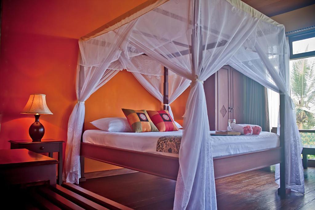 מיטה או מיטות בחדר ב-Villa Ma'Rasai