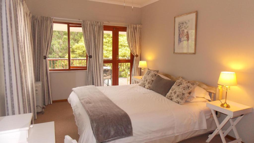 Cama ou camas em um quarto em Rivertide Lodge