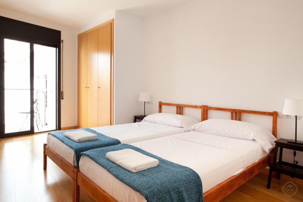 Cama ou camas em um quarto em Guell Modern Apartment