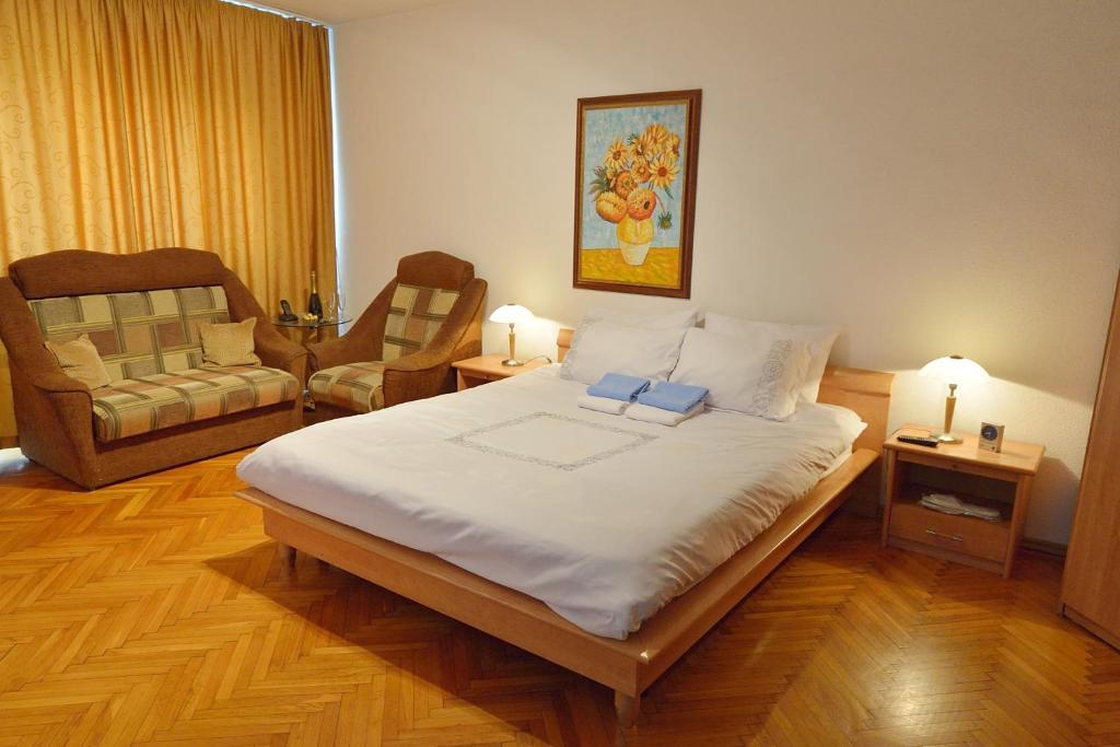 מיטה או מיטות בחדר ב-Atlas Accommodation Studio Romana de Lux